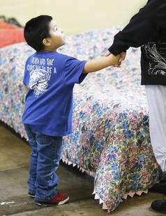 Darian asks for a drink at the Road Home Winter Overflow Shelter in Midvale Tuesday, Feb. 18, 2014. (Jeffrey D.