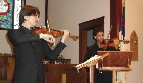 Alexander Marte and Geofrey Cua played violin, and Beatrice Serban accompanied on the piano.