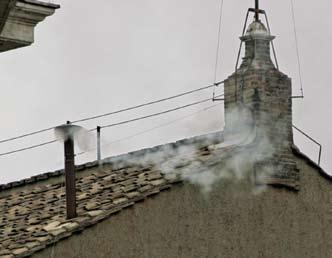 26 POPE BENEDICT XVI White smoke is released from the Sistine Chapel chimney on April 19, 2005, signaling the election of Pope Benedict XVI.