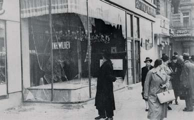 40 POPE BENEDICT XVI A pedestrian looks at a vandalized Jewish-owned shop in Berlin on November 10, 1938, the day after Kristallnacht, or the night of broken glass.