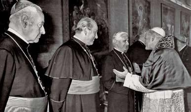 76 POPE BENEDICT XVI Cardinal Joseph Ratzinger greets Pope John Paul II as the newly elected pope receives German cardinals in the Vatican Apostolic Palace on October 18, 1978.