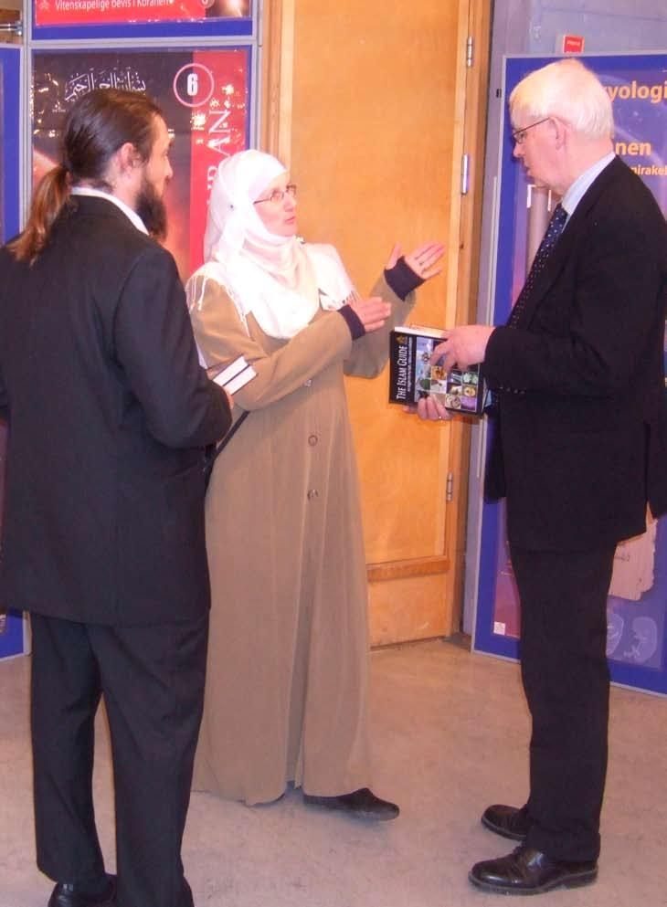 Ole D Mjos, Head of the Nobel Prize Committee being presented with Exhibition Islam s publication The Islam Guide by Sandra Maryam Moe and