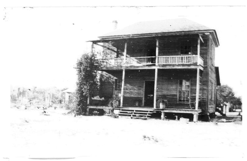 Figure 4.12. Undated photograph of the 1881 jail when it was used as a private home. (Image reproduced with permission of Howard Melton) balcony was likely added after it became a family home.