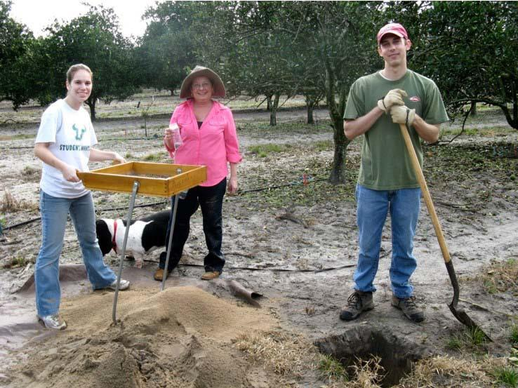 Figure 5.7. Shovel testing at the Pine Level site with community members and student volunteers. From left to right, Shannon McVey, Bebe Bradbury, and Kyle Freund are pictured.