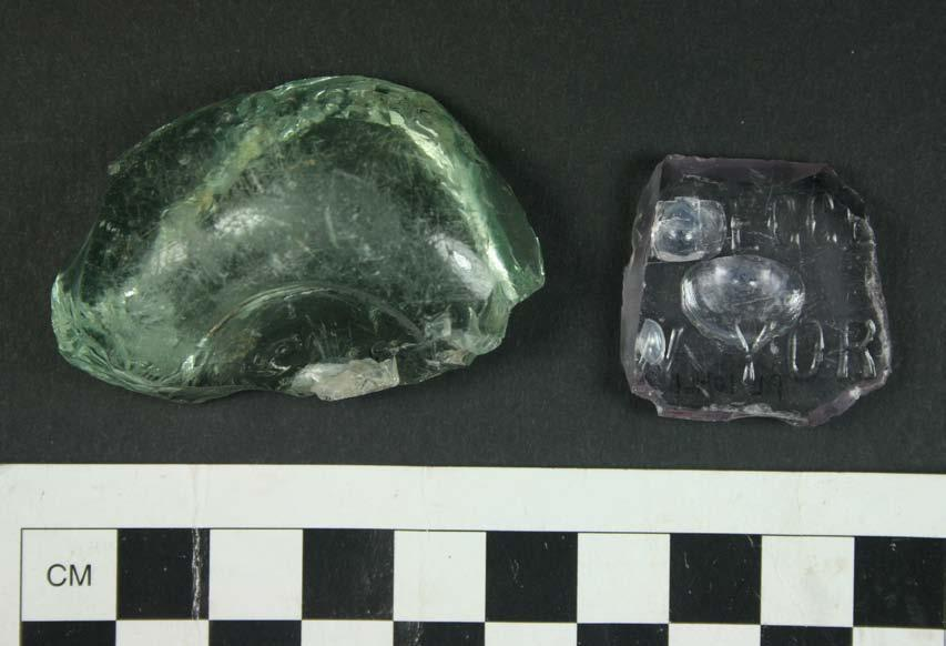 Figure 6.6. Two fragments of food-related bottles, from Area B of the Pine Level site. original contents of this bottle are unknown.
