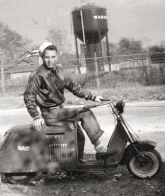Jesuit Brother & Scooter at the Smithsonian Museum As an adventuresome sixteen year old, Tom Bracco of Springfield, Illinois, fell in love with a 1945 Cushman Model 52 Pacemaker