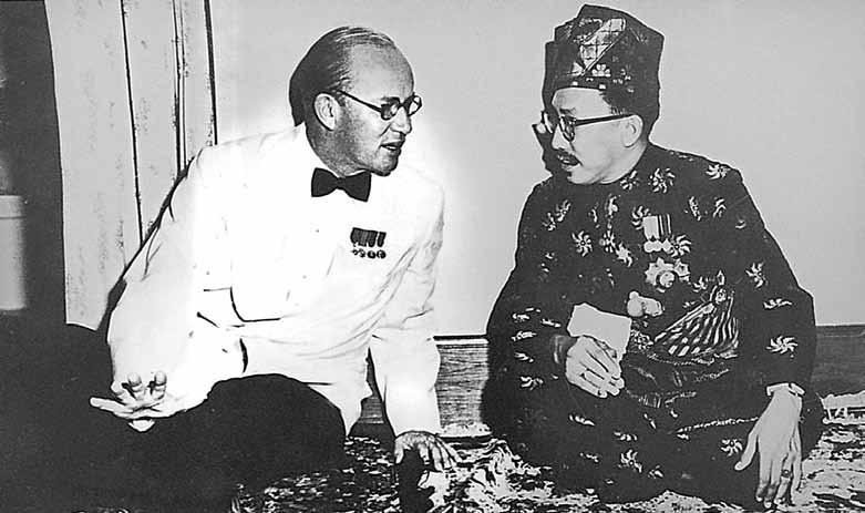 Hon ble Malcolm, MacDonald, and in the left are HRH Sultan Haji Omar Ali