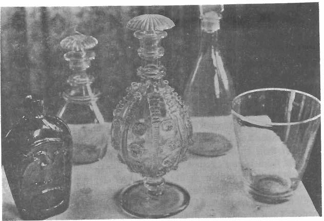 Gla ssware in front row made by Marlboro Street factorytum bler & decanter under Schoolcraft in 1816; flask by a lat er concern; Iwo rear de cant ers of unknown origin dians whereby 16,000,000 acres