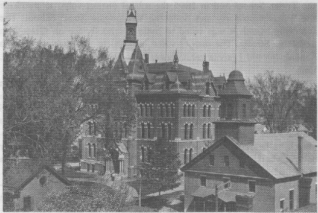"The ""new"" high school, later Central Junior High (site of present Winter Street parking lot) emy bell (now preserved by the Historical Society of Cheshire County and set in a standard made from"