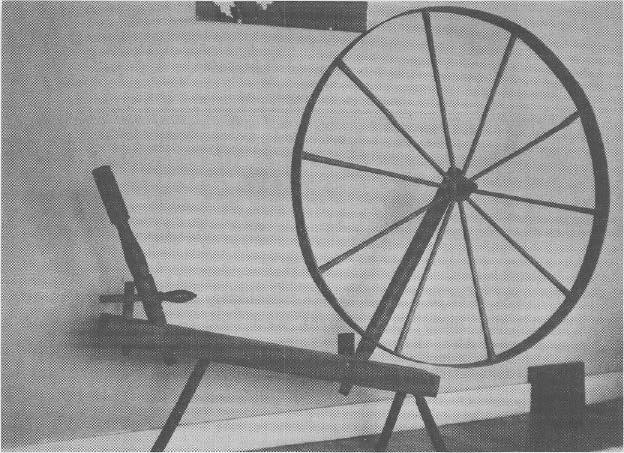 "Spinning wheel marked ""A&A Wilder"" circa 1812 many years and, as he also sold candies, toys, small wares, and homemade beer on the premises, his one-room shop knew many happy customers."