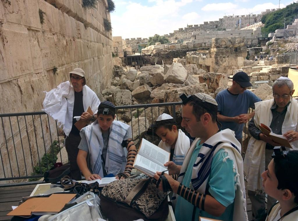on Tefillin & Talit while praying at Robinson s Arch (also known as Ezrat Israel).