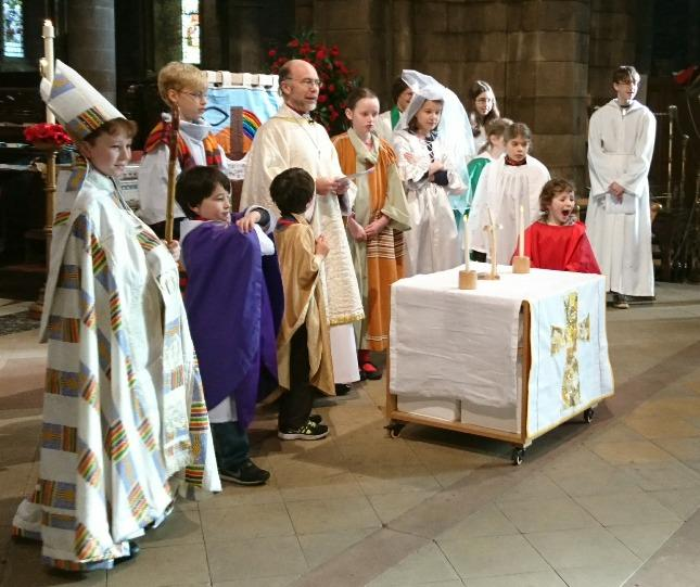 The children who came did indeed make themselves at home, by dressing up in the play church vestments and wedding clothes, by dancing in the aisles, by sitting on the steps next to Bishop John and by