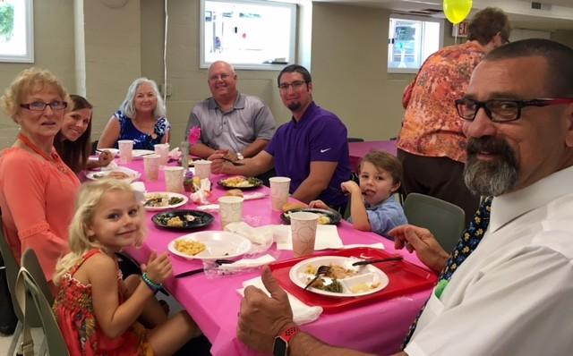 Lucas and Brooklyn Petty enjoying lunch with their grandparents.