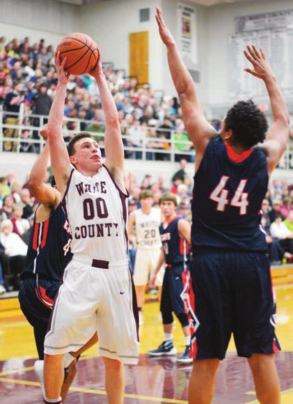 Herald-Citizen Sunday, January 17, 2016 SPORTS F White County sweeps CHS in comeback thrillers Ben Craven Herald-Citizen White County s Cade Crosland tries to put up a shot as Cookeville s Bryric