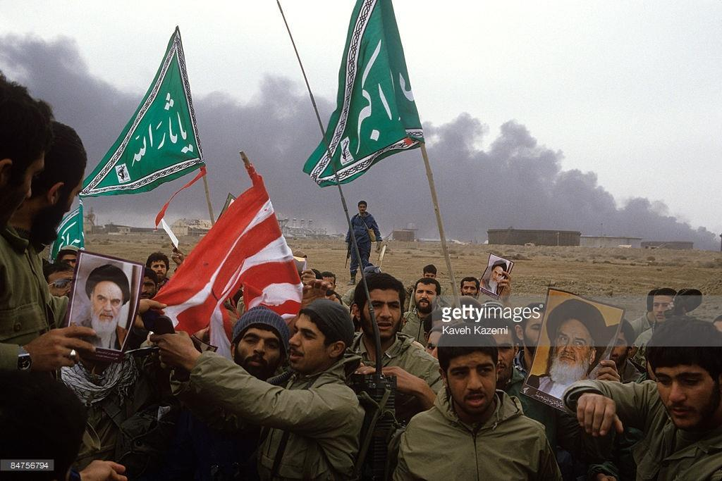 Foreign involvement Iran's Revolutionary Guards prepare to burn an American flag on the al- Fao Peninsula