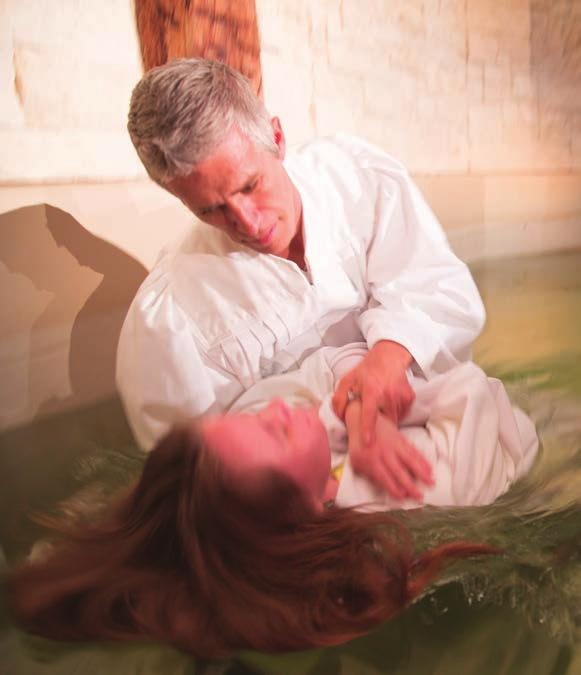 At this time you will lean backwards and be placed under water. Pastor Chad will make sure you don t fall.