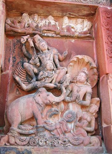 Vishnu descends to earth on the back of Garuda (mythical bird creature that appears in both Buddhist and Hindu mythology. Sometimes shown as an eagle.