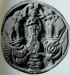 Shunga, 2nd Century BCE, Lakshmi as the lotus goddess bathed by elephants holding uptruned pots in their trunks.
