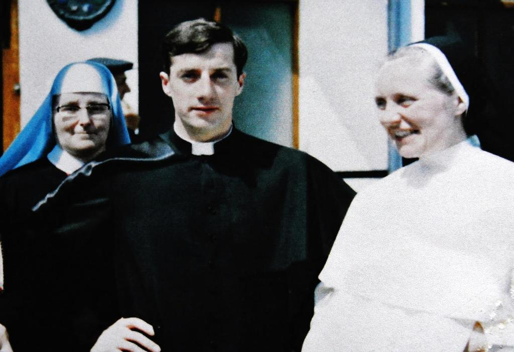 Father John with two of his