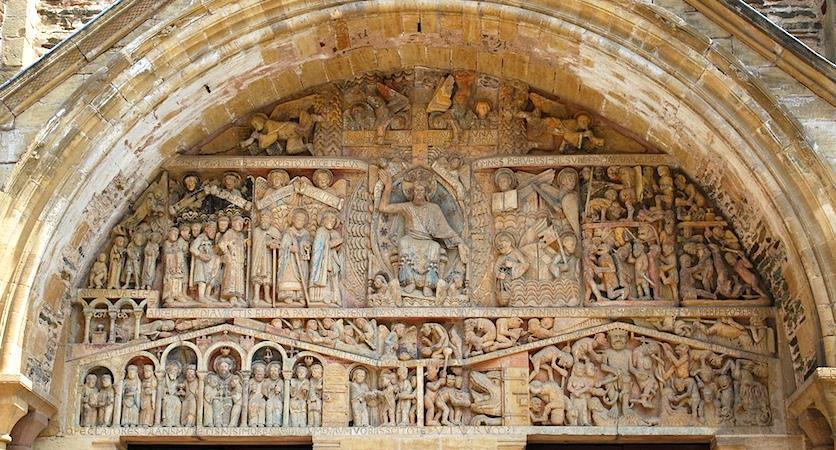 This scene is depicted on the tympanum, the central semi-circular relief carving above the central portal. In the center sits Christ as Judge, and he means business!