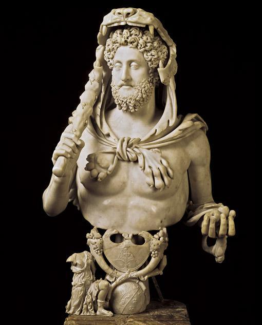 Title: Commodus as Hercules He claimed a relationship to Hercules and ordered many statues representing him as this Greek hero--here with the lion's skin over his head, the club in his right hand,