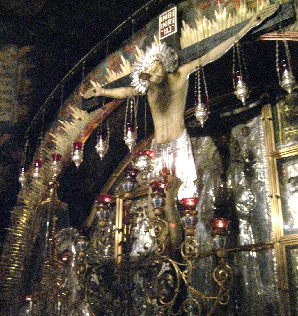 12 th Station: Greek Orthodox Chapel marks the site of the crucifixion Below the altar, on either