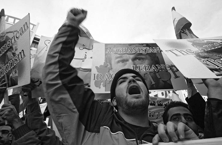 AFP Lebanese supporters of the Shiite militia Hezbollah chant anti-u.s. slogans during a protest in front of the government house in Beirut, where a U.S. envoy was meeting with Lebanese officials, 14 January 2006.