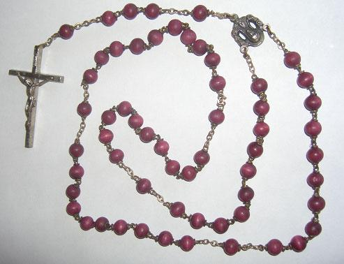 altar A rosary (a) Give two reasons why some Roman Catholics use a rosary when