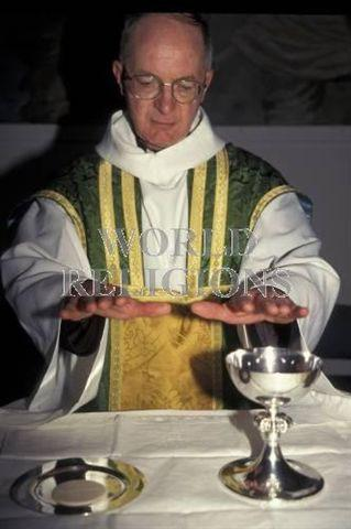 A4 The Eucharist Look at the photograph below. (a) Give another name for the Eucharist used in a Protestant tradition.