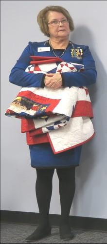 Laura presented quilts to eight OMC veterans for their military  Left: personalized inscription on quilts with
