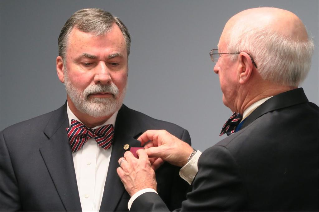 President Dan Philbrick (right) presented the Chapter Distinguished Service Medal
