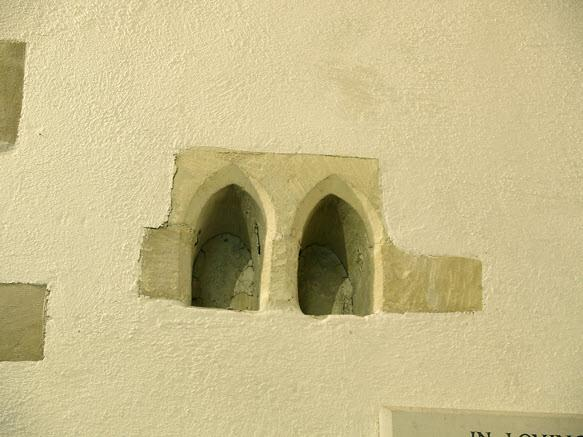 ...The two arched alcoves, left, on the north wall which might have contained bells, relics or, it has been suggested, the hearts of people revered or prayed