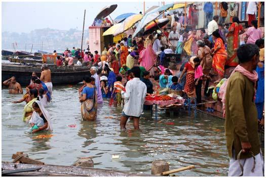 on the Ganges River where Hindus perform morning rituals Slide 37