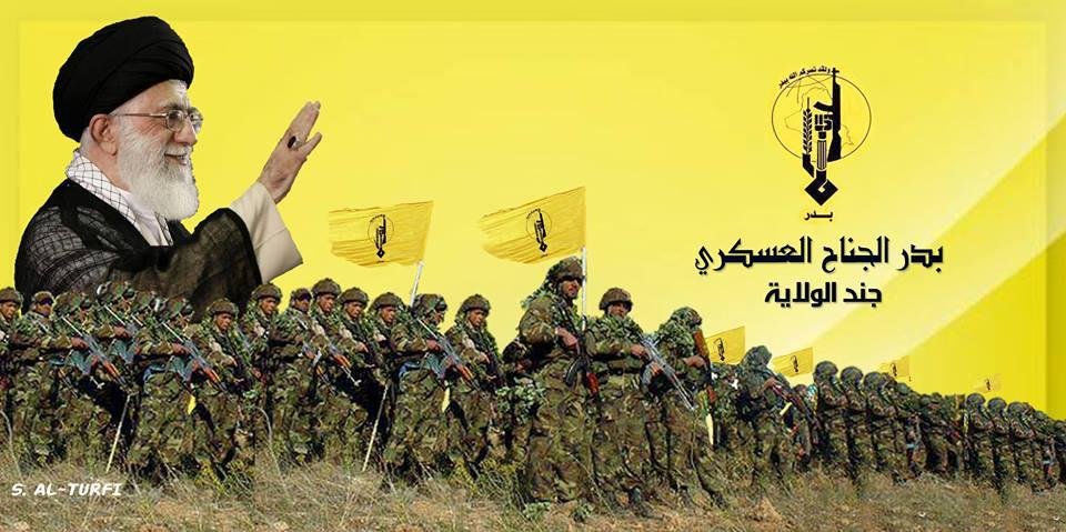 Figure 9: Iran s Supreme Leader waves and smiles as Badr Organization militiamen stand below him.