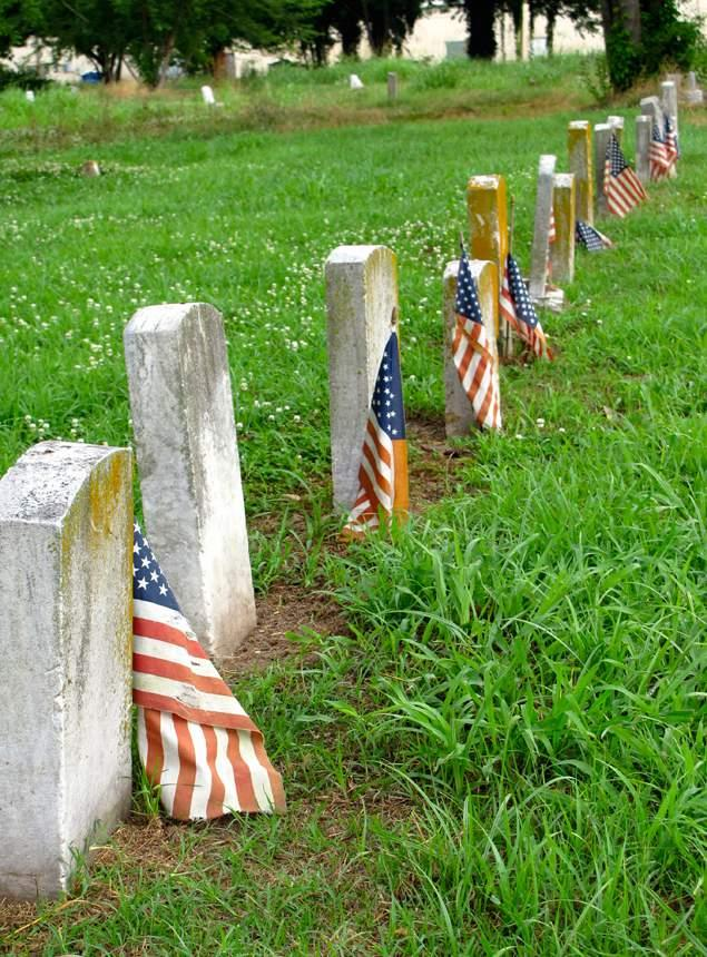 rican flags decorate the graves of African Ame
