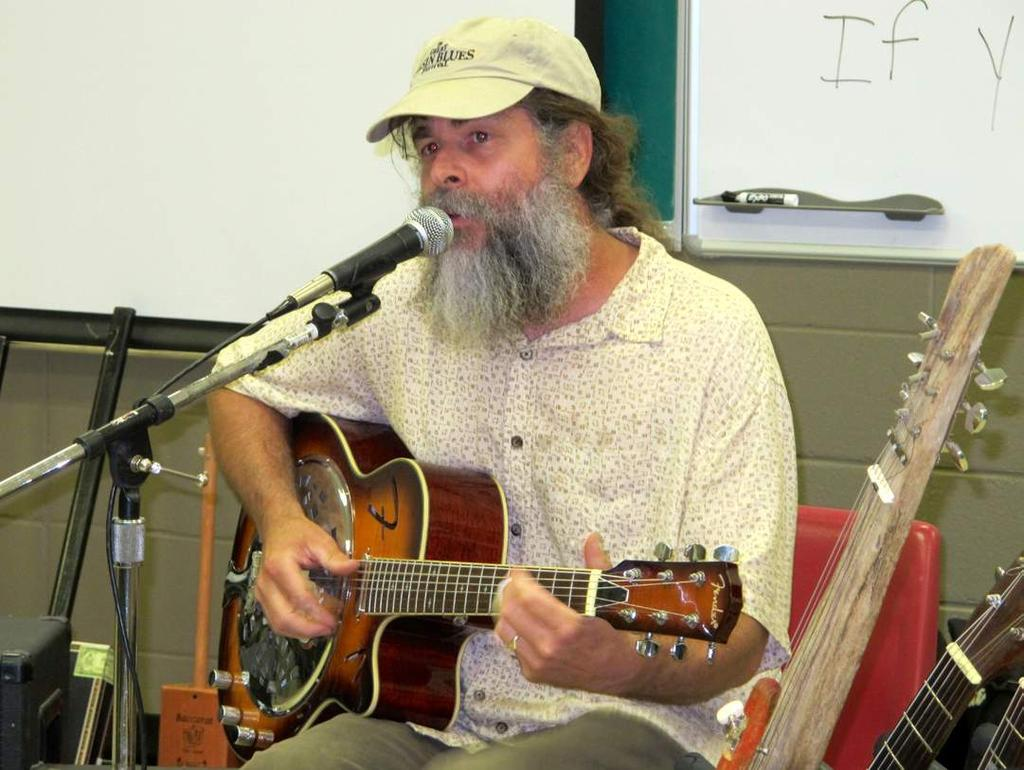 JULY 9, 2013 Musician Bill Abel from Clarksdale performs authentic, Delta Blues with acoustic, electric, and cigar box guitars, and foot drums.