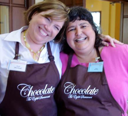 14 reflection Chocolate Fest raises $20K for community ministry Terri Moorhead, chair of the Chocolate Fest, celebrates with Connie Reyes-Rau, an ECSF board member.