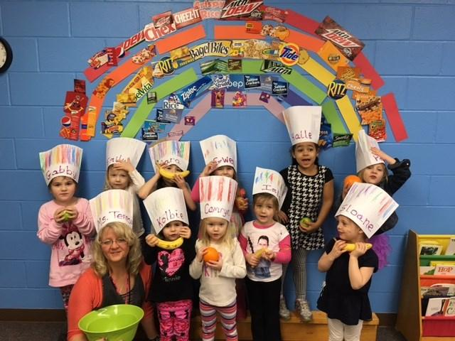P A G E 6 our classroom. The next class meetings were all about cooking. Both classes decorated chef hats and wore them while adding ingredients to our recipes.