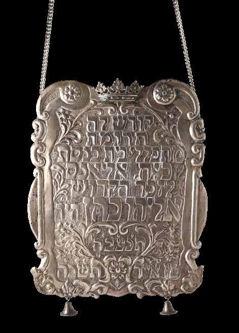82 Torah Breastplate. Silver, in Memory of Israeli Spy Eli Cohen. 1965 Silver breastplate from the worshipers in the Alliance Synagogue in memory of Eli Cohen. Israel [1965].