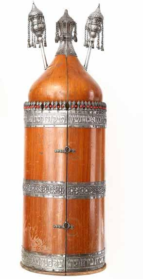 83 Torah Scroll with Case and Finials. Iraq. 20th Century Torah Scroll on gevil, within a magnificent wood case integrated with silver strips and with original silver finials. Iraq. End of the 1940s.