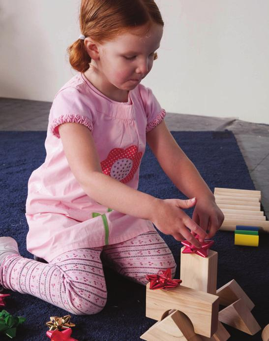 Play to Learn Bible Verse Activities Blocks Center Bible, blocks, a variety of Christmas decorations (garland, unbreakable ornaments, etc.), self-stick gift bows.