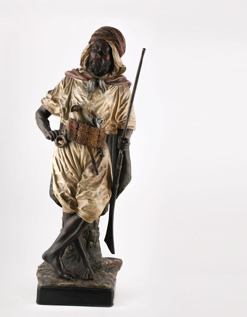 65. Joseph Le Guluche (French, 1849-1915) Kabyle Warrior جوزيف لو جولوش )فرنسي 1849-1915( محارب القبائل Polychrome-patinated terracotta figure of a warrior with moveable riffle. signed on the base «J.