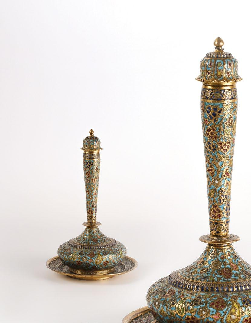 5 cm Out of cover approx 27 cm $ 2,000-3,000 QAR 7,300-10,950 132 A Gilt Brass and Enameled Kashmir Scented Water Flask Surahi with Tray قارورة مياه معطرة وصينية من النحاس املذهب واملينا على طراز