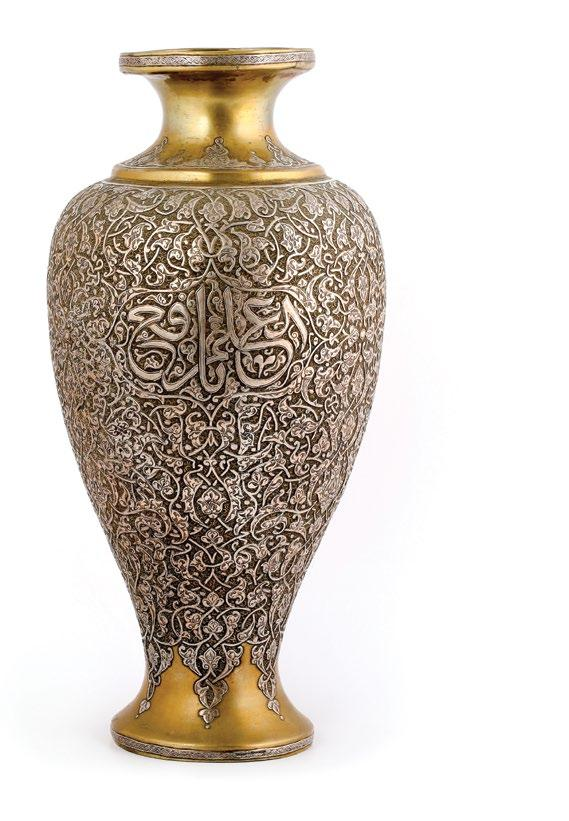 135. A Syrian Islamic Brass Vase مزهرية نحاسية بنقوش إسالمية مرصعة بالفضة with silver inlay, decorated with endless knot, ornate interlacing arabesque design overall and cartouches with calligraphy.