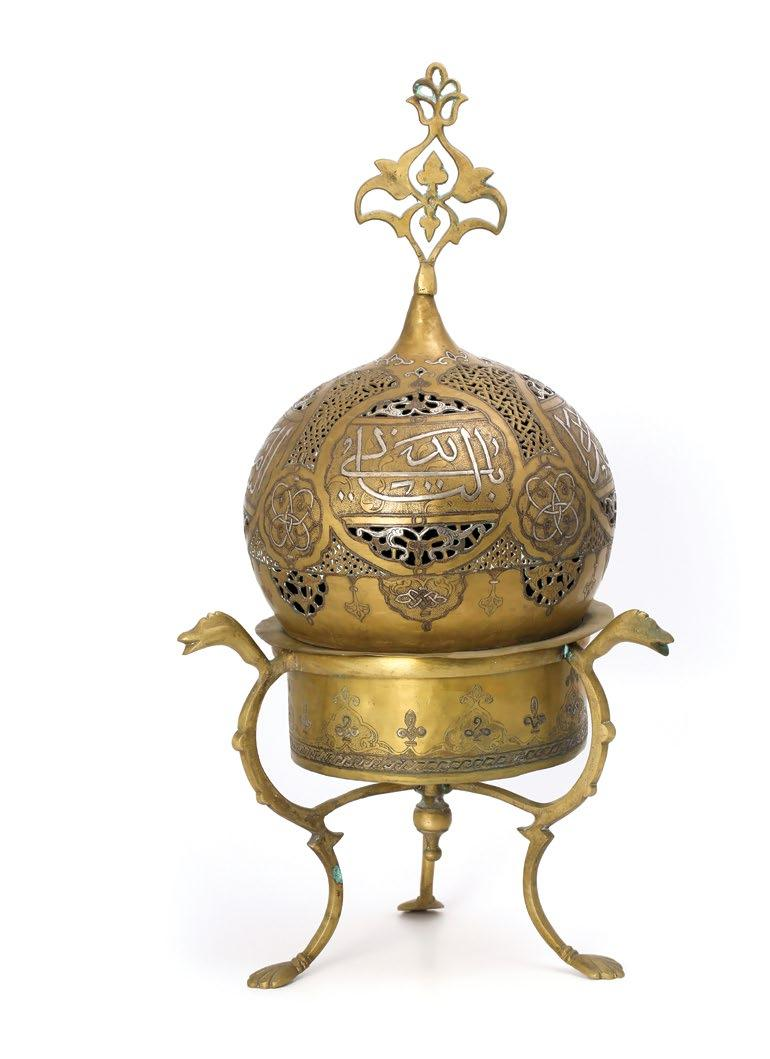 139. A Syrian Islamic Pierced Brass Incense Burner مبخرة نحاسية سورية بنقوش إسالمية مرصعة بالفضة والنحاس damascened with silver and copper endless knot medallions, foliage and cartouches of