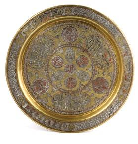 143. A Syrian, Islamic, Brass Tray صينية نحاسية سورية بنقوش إسالمية مرصعة بالفضة والنحاس damascened silver and copper band of arabesque motif and endless knot surrounding a central floral band