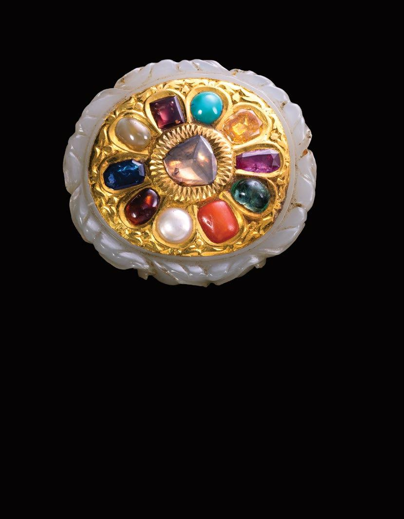 211. A Diamond And Ruby Ring خامت من األملاس والياقوت South India 19th Century Length 3.5 grams Width 2.5 grams Weight 15.1 grams 17,000-19,000 QAR 62,050-69,350 212.