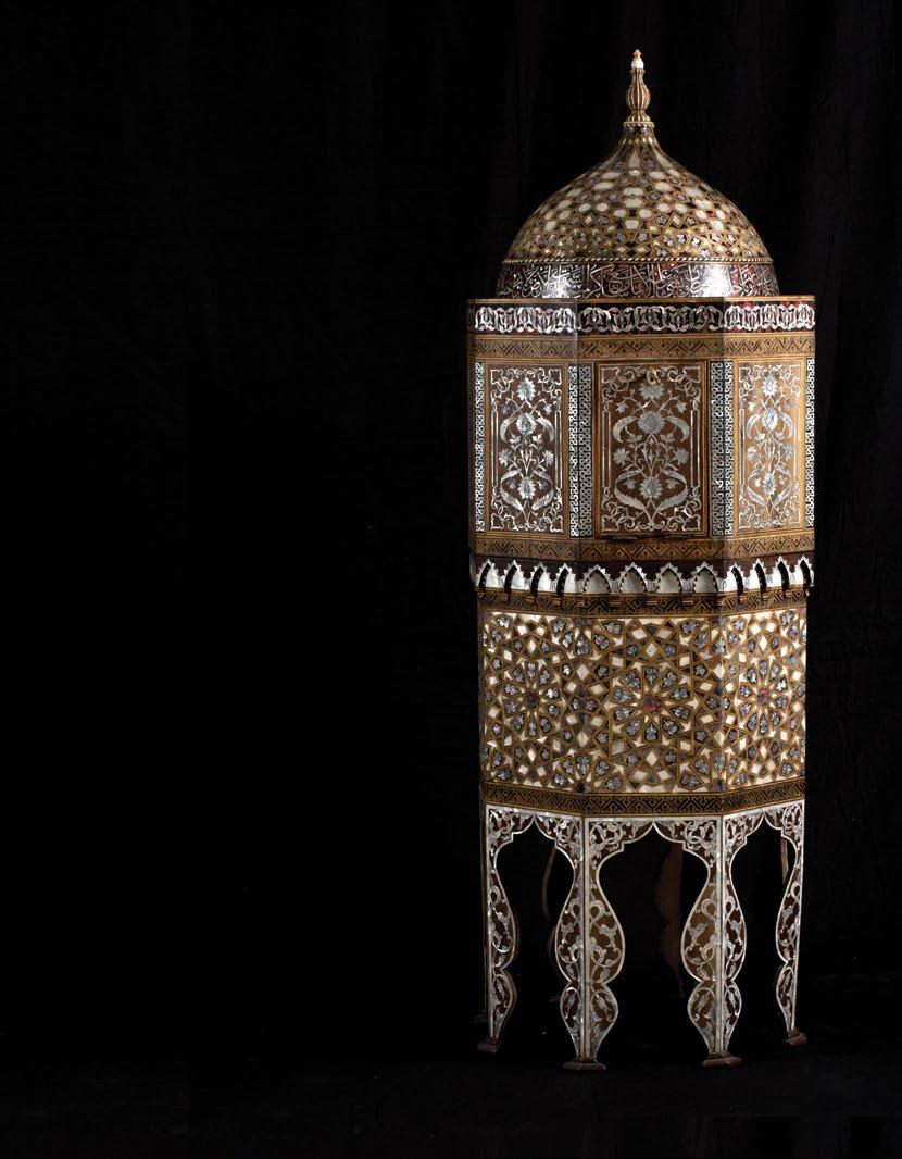The octagonal shaped middle section with a band of inlaid tortoiseshell and mother-of-pearl interlacing floral motifs surrounding the top Mother-of-pearl inlaid interlacing foliage and arabesque