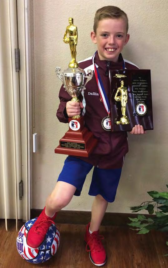 Jensen (above) wears some of the medals he won at local, district, state and regional competitions. He holds the trophy he won as Most Outstanding Shooter at the regional competition in Las Vegas.