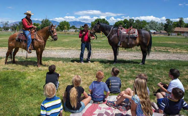THURSDAY June 21, 2018 A9 CAMPING OUT FUN AT CLARK FARM PHOTOS FRANCIE AUFDEMORTE National Pony Express Association members Jerry Hurst and Pat Hearty (above) talk to campers about the Pony Express